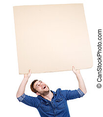 man holding blank poster sign up - Portrait of a handsome ...