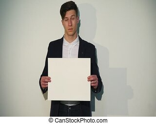 man holding board or white blank
