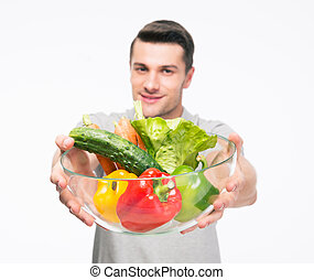 Man holding bowl with vegetables