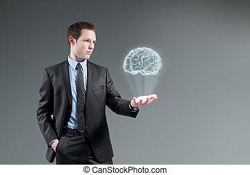 Man holding brain Hologram. Futuristic technology concept.