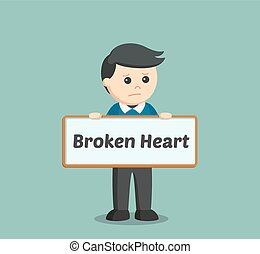 man holding broken heart sign