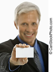 Man holding business card.