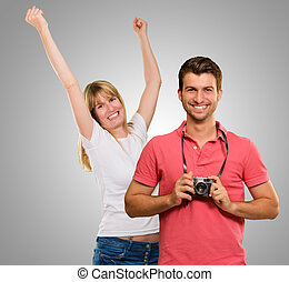 Man Holding Camera In Front Of Dancing Woman