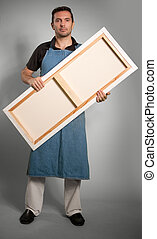 Man holding canvas