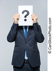 Man holding card with question mark