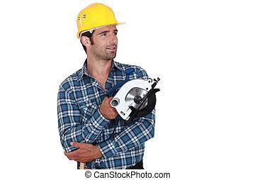 Man holding circular-saw
