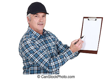 Man holding clip-board and pen