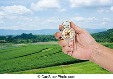 man holding compass in hand