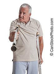 Man Holding Crutch Like a Weapon