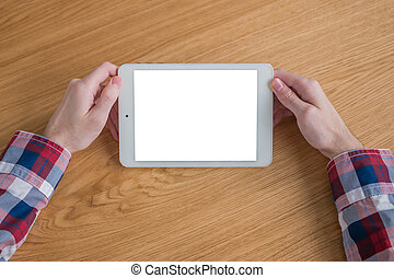 Man holding digital tablet device with white blank screen - mockup image