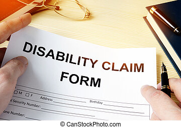 Man holding disability claim form for insurance.