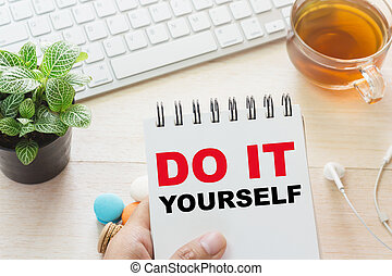 Man holding DO IT YOURSELF message