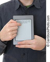 Man holding E-book reader in hands. LOREM IPSUM text on...