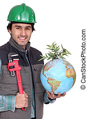 Man holding globe and wrench