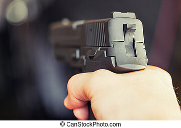 Man holding gun in hand and ready to use it