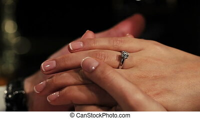Man holding hands woman with engagement ring with diamond on finger. Romantic.