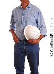 Man in blue jeans and work shirt holding a hardhat - isolated over white
