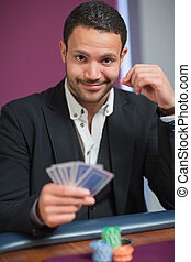 Man holding his cards