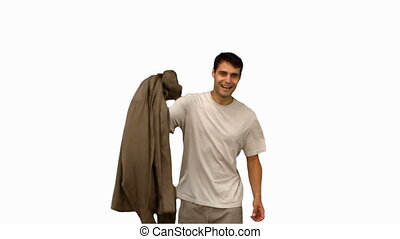 Man holding his coat on white screen in slow motion