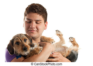 Man Holding His Dog - High key portrait of a young man...