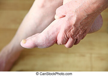 Man holding his foot