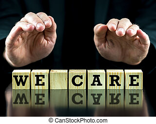 We care - Man holding his hands protectively over words We...