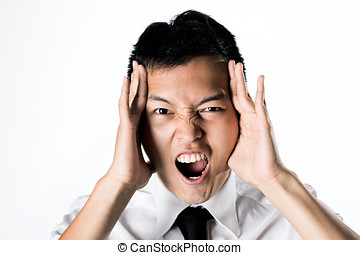 Man holding his head in distress - Asian business man...