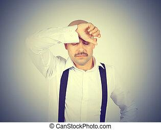 man holding his head pain.