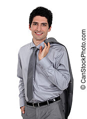 Man holding his suit jacket over his shoulder