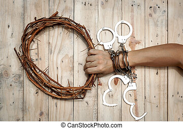 Man Holding Jesus Crown Thorns with His Hand and Many Handcuffs.