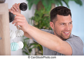 man holding lights at home