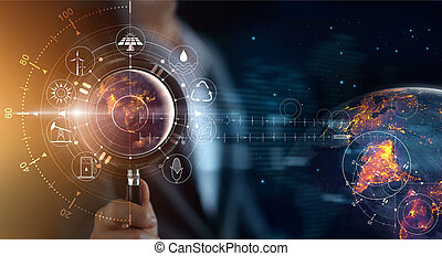 Man holding magnifying glass, search earth with lights in the night of global show the world's consumption with icons energy sources for renewable, sustainable development. Ecology concept. Elements of this image furnished by NASA.