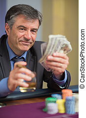 Man holding money and smiling
