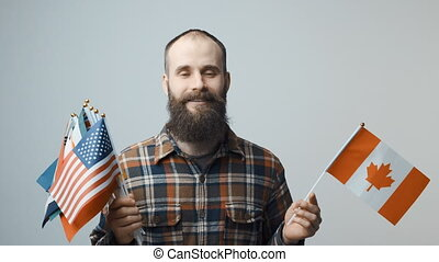 Man holding national flags