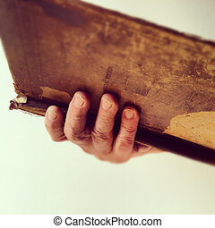 Man holding old book