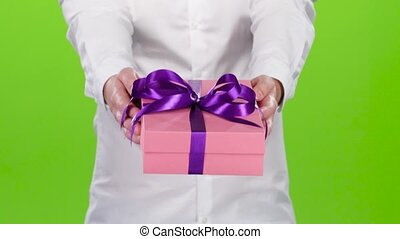Man holding out a box with a gift. Close up
