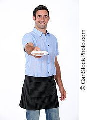man holding out saucer