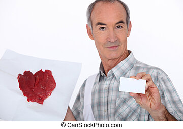 Man holding painting and business card