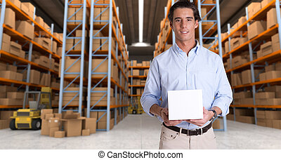 Man holding parcel in warehouse a