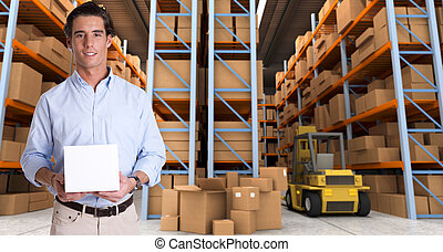 Man holding parcel in warehouse b