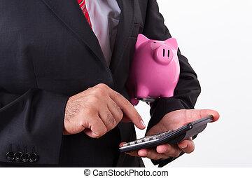 Man Holding Piggy Bank and Calculator