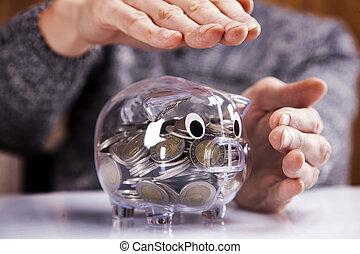 Man holding piggy bank!