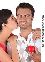 Man holding plastic heart