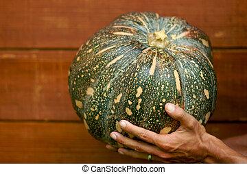 Man holding pumpkin