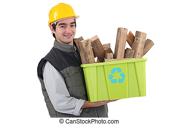 Man holding recycle box full of scrap wood