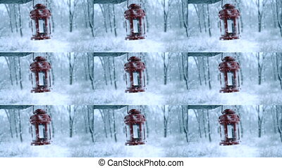 Man holding red candle lantern in winter forest. Snow forest snowfall.