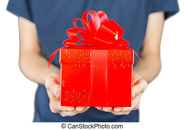 Man holding red christmas gift in front of body