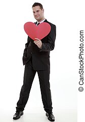 man holding red heart in his hand love symbol