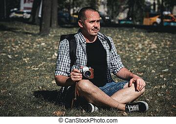 Man holding retro camera. Vintage camera. Photographer.