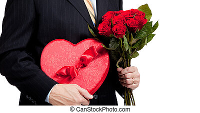 Man holding roses and red heart with chocolates on white